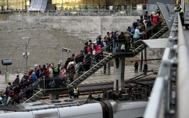 Police organize a line of refugees on a stairway leading up to trains arriving from Denmark at the Hyllie train station outside Malmo, Sweden, November 19, 2015. REUTERS/Johan Nilsson/TT News Agency
