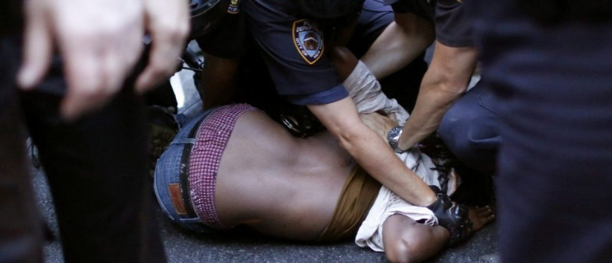 A protestor is detained by NYPD officer as people take part in a protest against the killings of Alton Sterling and Philando Castile during a march along Manhattan's streets in New York July 7, 2016. REUTERS/Eduardo Munoz