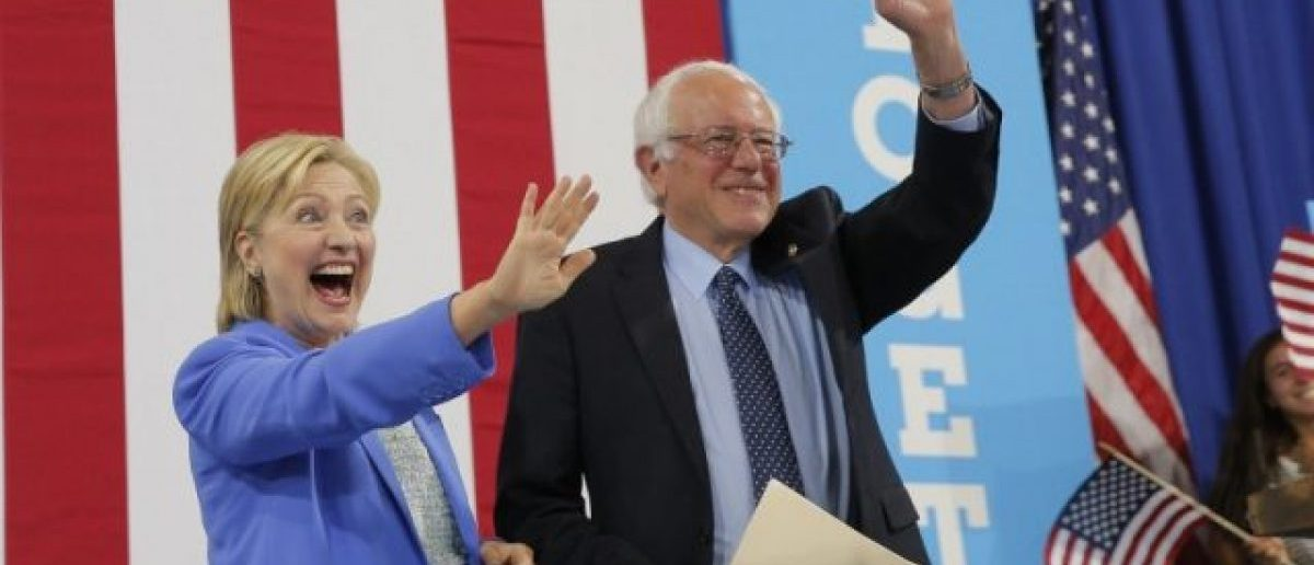 (Photo: ReDemocratic U.S. presidential candidate Hillary Clinton and Sen. Bernie Sanders stand together during a campaign rally where Sanders endorsed Clinton in Portsmouth, New Hampshire, U.S., July 12, 2016. (REUTERS/Brian Snyder)