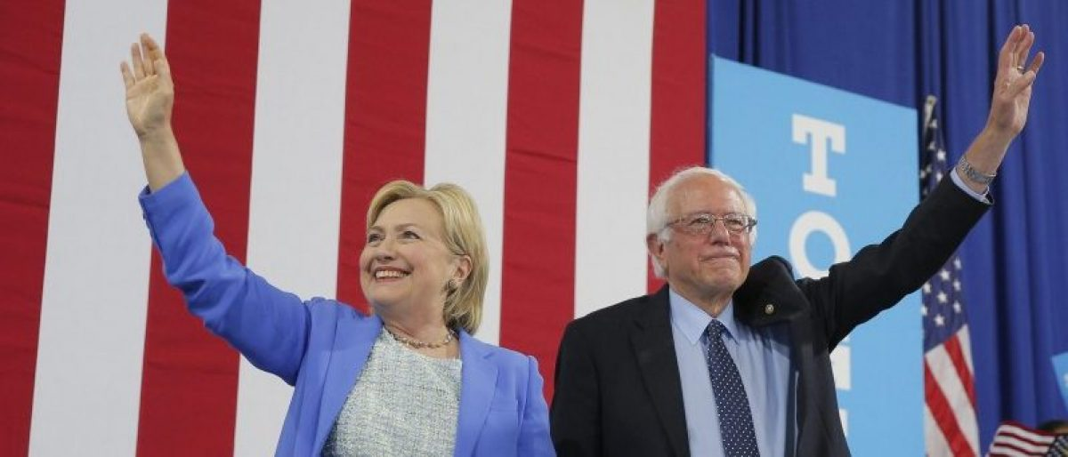 Democratic U.S. presidential candidate Hillary Clinton and Sen. Bernie Sanders stand together during a campaign rally where Sanders endorsed Clinton in Portsmouth, New Hampshire, U.S., July 12, 2016. REUTERS/Brian Snyder
