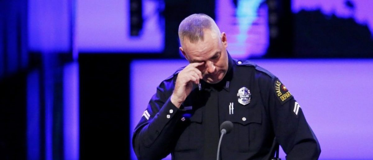 Dallas police officer Eddie Coffey reacts while speaking at the funeral for Officer Lorne Ahrens in Plano, Texas, U.S. July 13, 2016. Five officers, including Ahrens, were killed in a shooting incident in Dallas July 7. REUTERS/Carlo Allegri