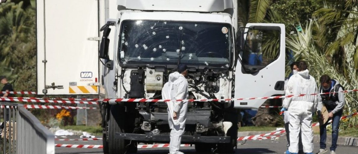 Investigators continue to work at the scene near the heavy truck that ran into a crowd at high speed killing scores who were celebrating the Bastille Day July 14 national holiday on the Promenade des Anglais in Nice