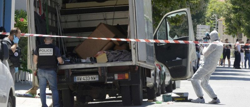 French investigating police conduct a search for clues of around a truck, the day after a heavy a truck ran into a crowd at high speed killing scores and injuring more who were celebrating the Bastille Day national holiday, in Nice