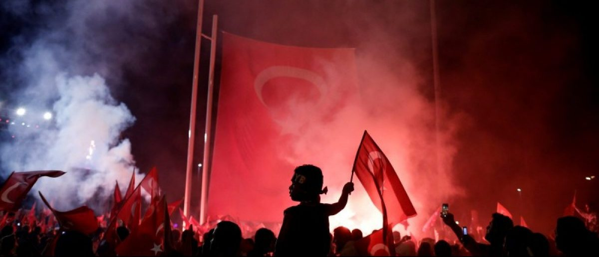 A young boy waves a Turkish national flag as supporters of Turkish President Tayyip Erdogan gather during a pro-government demonstration on Taksim square in Istanbul, Turkey, July 18, 2016. REUTERS/Alkis Konstantinidis