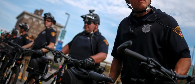 Police use bicycles to create cordons around protesters ahead of Republican National Convention in Cleveland, Ohio