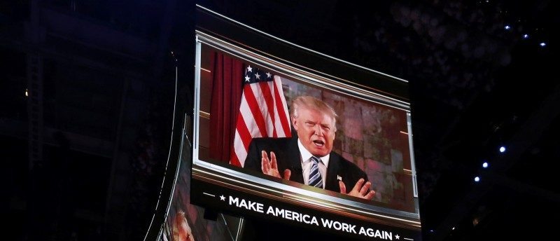 U.S. Republican Presidential Nominee Donald Trump is shown on video monitors as he speaks live to the crowd from New York at the Republican National Convention in Cleveland, Ohio, U.S. July 19, 2016.   REUTERS/Mario Anzuoni