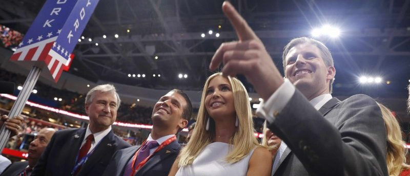 Members of Republican U.S. presidential candidate Donald Trump's family, son Donald Trump Jr. (2nd L), daughter Ivanka (C) and son Eric stand with the New York delegation during the nominating process at the Republican National Convention in Cleveland, Ohio, U.S. July 19, 2016. REUTERS/Aaron P. Bernstein