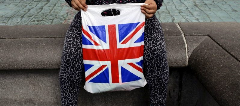 A woman holds a Union Flag shopping bag in London, Britain April 23, 2016.  REUTERS/Kevin Coombs/File Photo