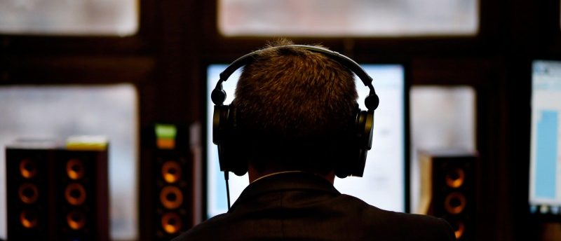 A man uses headphones while working at the Justice Ministry's Agency for comunications capturing in Buenos Aires