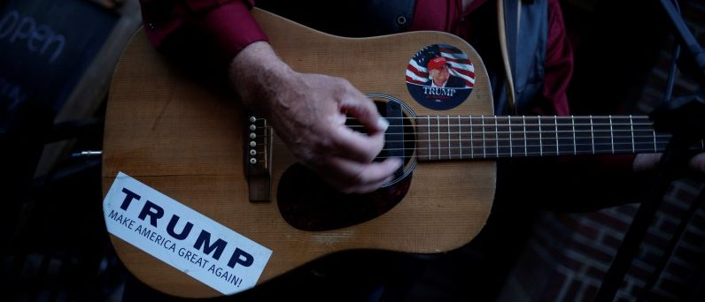 A man supporting Donald Trump plays a guitar near the site of the Republican National Convention in Cleveland, Ohio, U.S., July 20, 2016. REUTERS/Adrees Latif