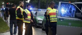 Police secure a street near to the scene of a shooting in Munich. REUTERS/Michael Dalder