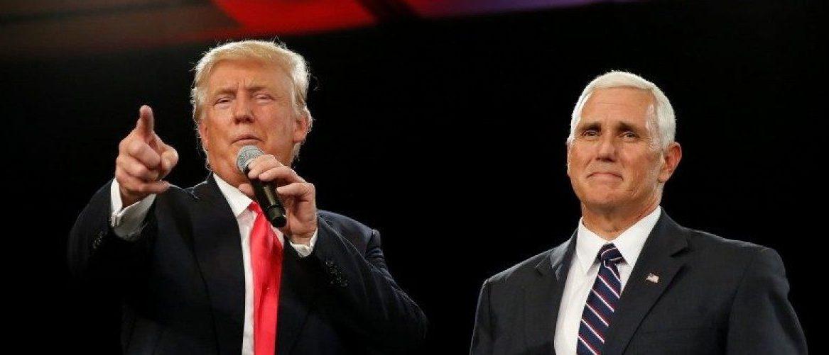 Republican presidential candidate Donald Trump (L) and vice presidential candidate Mike Pence speak at a campaign event in Roanoke, Virginia, U.S., July 25, 2016.  REUTERS/Carlo Allegri
