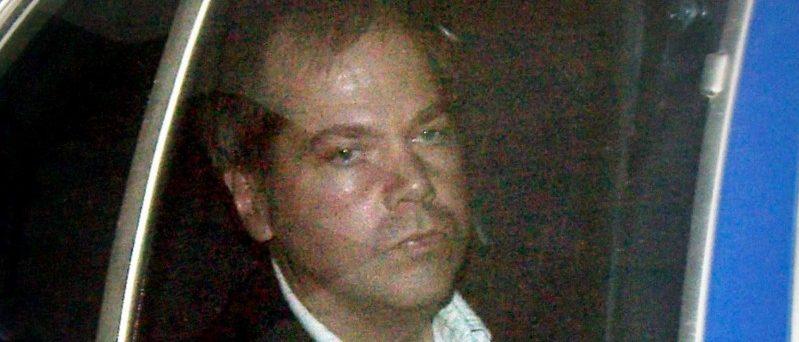 John Hinckley Jr. arrives at the E. Barrett Prettyman U.S. District Court in Washington November 19, 2003. REUTERS/Brendan Smialowski/File Photo