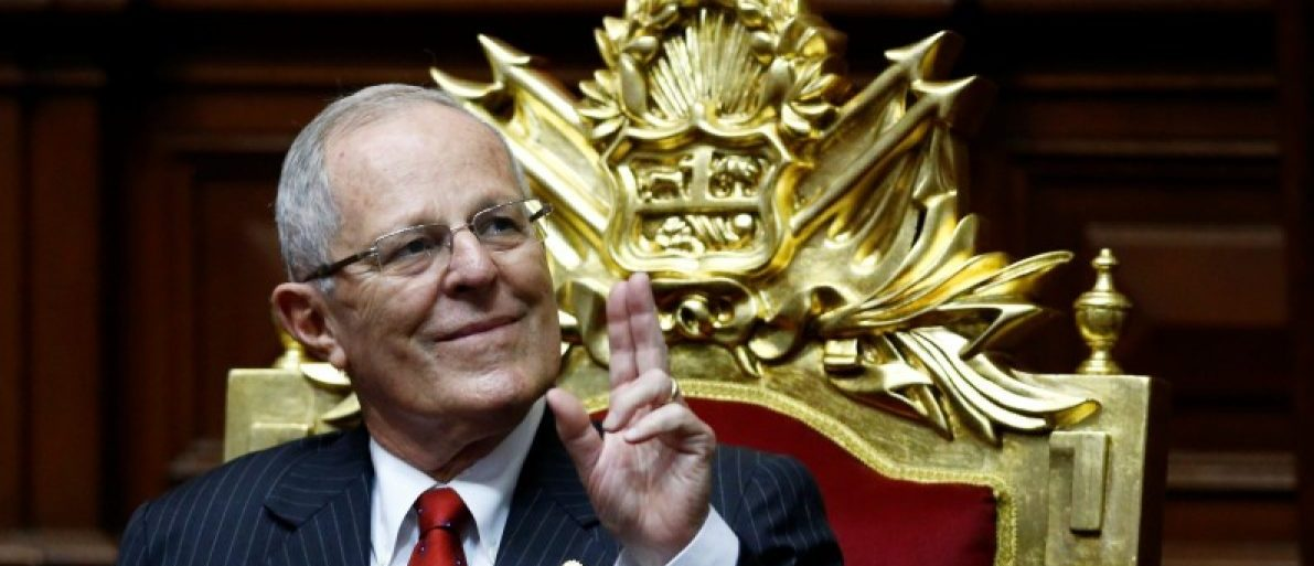 Peru's President-elect Pedro Pablo Kuczynski gestures before receiving the presidential sash during his inauguration ceremony in Lima