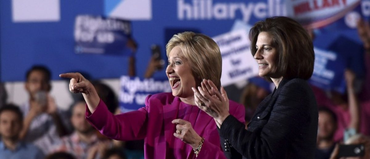 U.S. Democratic presidential candidate Hillary Clinton (L) appears on stage with Nevada Senate candidate Catherine Cortez Masto at a campaign rally at the Laborers International Union hall in Las Vegas, Nevada February 18, 2016. REUTERS/David Becker/File Photo