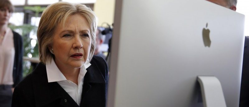 U.S. Democratic presidential candidate Hillary Clinton looks at a computer screen during a campaign stop at Atomic Object company in Grand Rapids, Michigan, U.S. March 7, 2016. REUTERS/Carlos Barria/File Photo