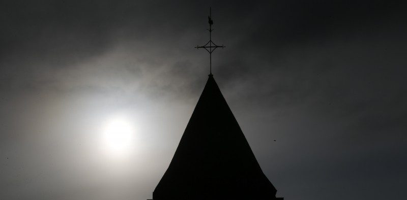 A view shows the bell tower of the church in Saint-Etienne-du-Rouvray near Rouen in Normandy, France, where French priest, Father Jacques Hamel, was killed with a knife and another hostage seriously wounded in an attack on the church that was carried out by assailants linked to Islamic State. REUTERS/Pascal Rossignol