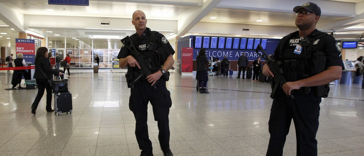 Atlanta police officers Herrick (L) and Reid (R) patrol at the check-in area as they carry sub-machine guns at Hartsfield-Jackson International Airport in Atlanta, November 17, 2015. REUTERS/Tami Chappell