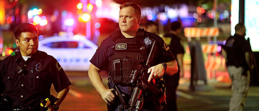 Dallas police stand watch near the scene where five Dallas police officers were shot and killed on July 7, 2016 in Dallas, Texas. (Photo by Ron Jenkins/Getty Images)