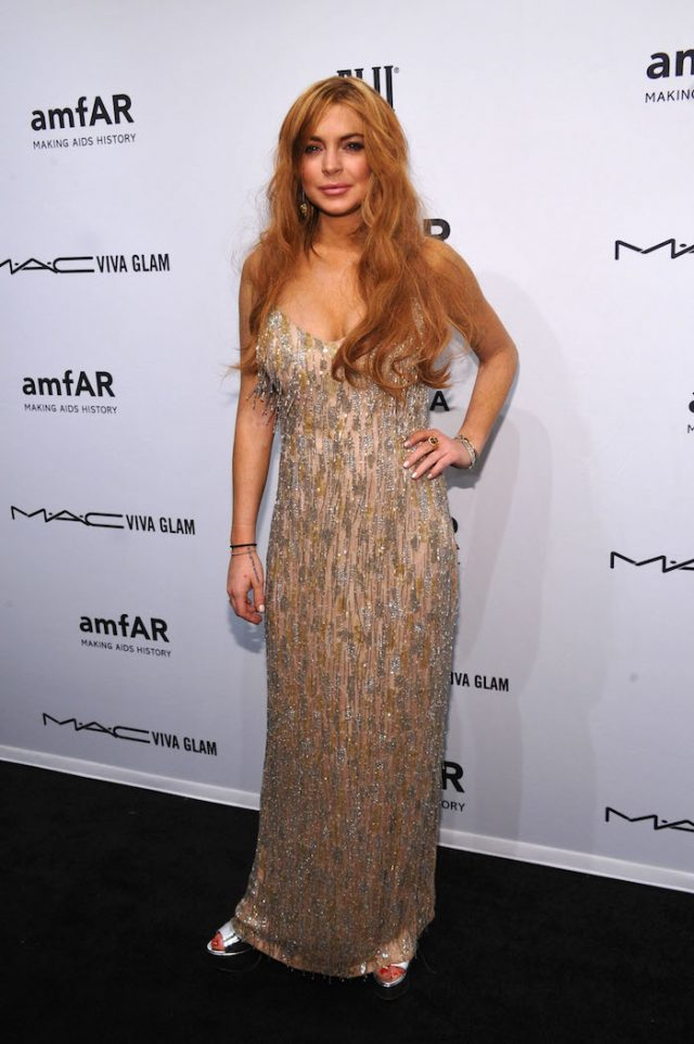 NEW YORK, NY - FEBRUARY 06: Lindsay Lohan attends the amfAR New York Gala to kick off Fall 2013 Fashion Week at Cipriani Wall Street on February 6, 2013 in New York City. (Photo by Bryan Bedder/Getty Images for FIJI Water)