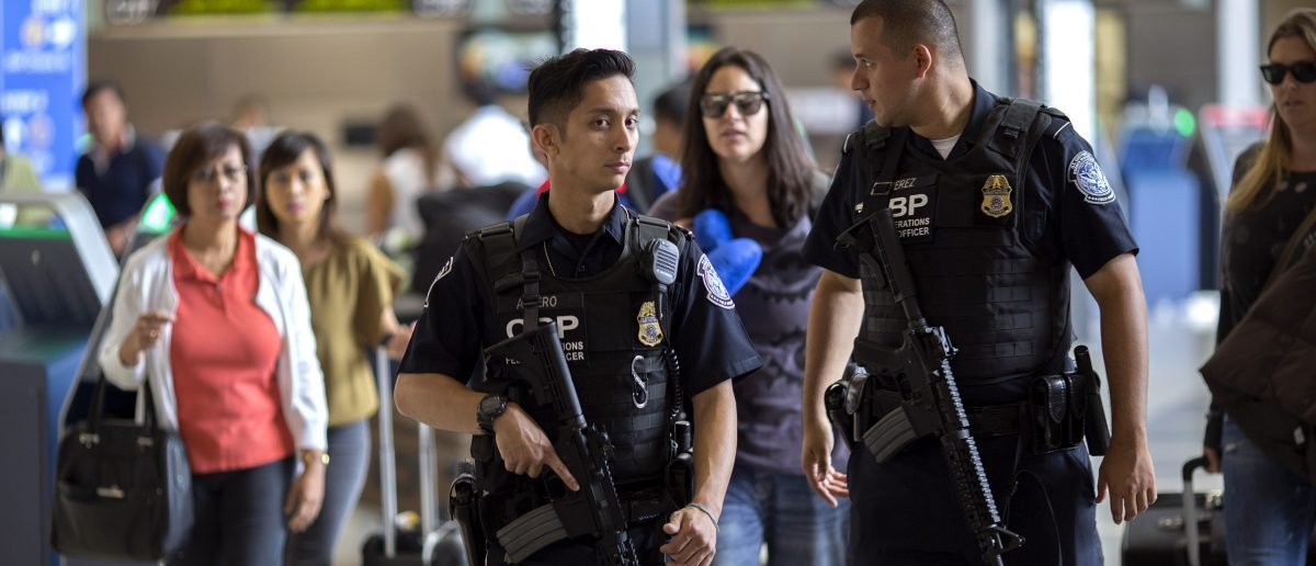 LOS ANGELES, CA - JULY 02: A U.S. Customs and Border Protection officers watch over travelers at Los Angeles International Airport on July 2, 2016 in Los Angeles, California. Security is stepped up for the busy Fourth of July travel weekend following deadly attacks on an airport in Turkey that claimed 44 lives, and in Bangladesh where 20 hostages were killed. A pro-ISIS twitter account threatened attacks at airports in Los Angeles, London Heathrow and New York JFK airports but officials are doubting its credibility. (Photo by David McNew/Getty Images)