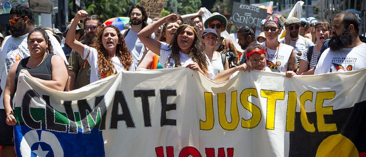 NOVEMBER 11: Demonstrators protest in the Brisbane CBD over climate change, uranium mining, coal seam gas fracking and traditional land rights. (Photo by Glenn Hunt/Getty Images)