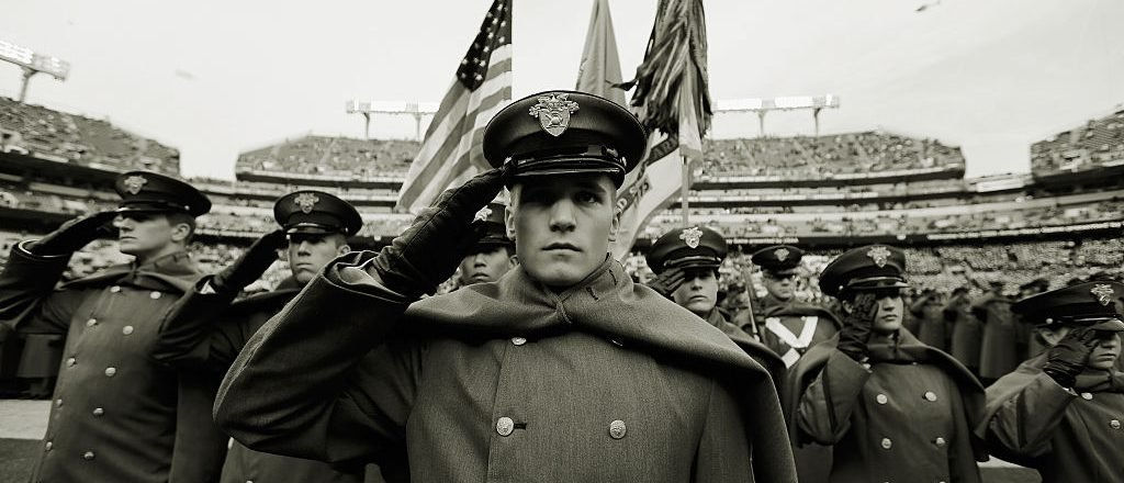 Army Cadets salute after taking the field before the start of the Army Black Knights and Navy Midshipmen game on December 13, 2014 in Baltimore, Maryland. (Photo by Rob Carr/Getty Images)