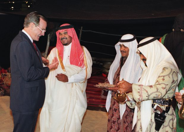 WASHINGTON, DC - AUGUST 9: US President George Bush (L) is treated to Arab coffee and cakes as he tours 09 August 1989 in Washington, D.C. an exhibition sponsored by the government of Saudi Arabia with Prince Bandar bin Sultan bin Abdul Aziz al-Saud (C), the Saudi ambassador to the US. Prince Bandar was born in March 1949 at Taif, son of Prince Sultan bin Abdul Aziz al-Saud, the Second Deputy Prime Minister, Minister of Defense and Aviation. AFP PHOTO GREG GIBSON (Photo credit should read GREG GIBSON/AFP/Getty Images)