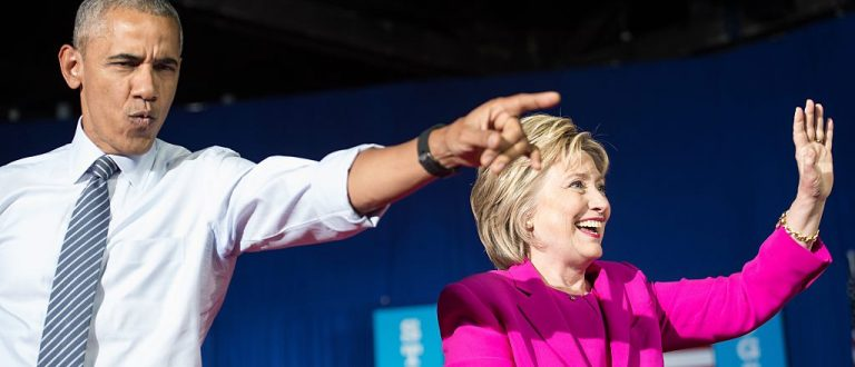 Barack Obama and Hillary Clinton arrive at a campaign event in Charlotte, North Carolina (Getty Images)