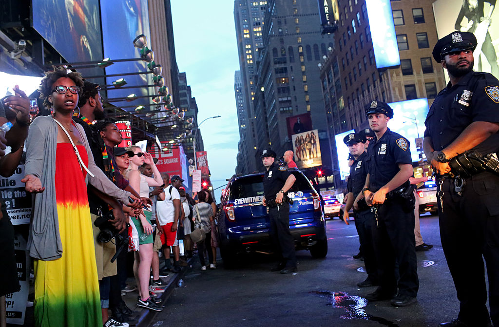 Activists protest in Times Square in response to the recent fatal shootings of two black men by police (Getty Images)