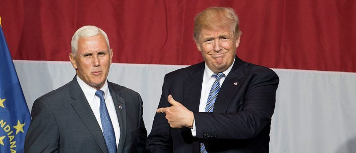 Donald Trump (R) and Indiana Governor Mike Pence (L) take the stage during a campaign rally at Grant Park Event Center in Westfield, Indiana. (Getty Images)