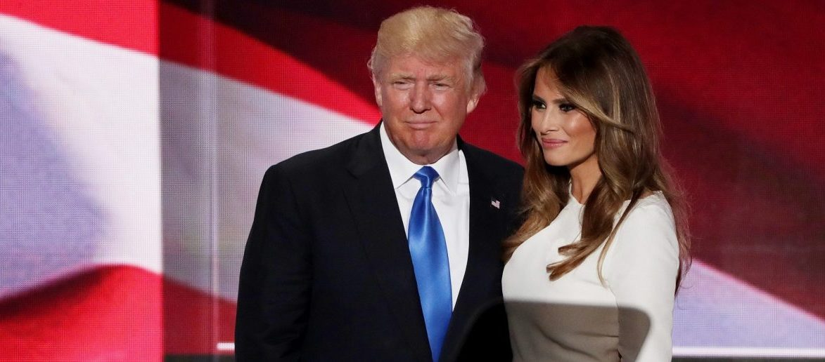 CLEVELAND, OH - JULY 18: Presumptive Republican presidential nominee Donald Trump stands with his wife Melania after she delivered a speech on the first day of the Republican National Convention. (Photo by Alex Wong/Getty Images)
