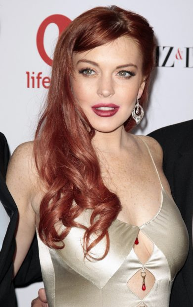 """Actress Lindsay Lohan arrives for a private dinner celebrating the upcoming premiere of """"Liz & Dick"""" at the Beverly Hills Hotel in Beverly Hills, California November 20, 2012. """"Liz & Dick"""" is a movie starring Lohan as Elizabeth Taylor. REUTERS/Jason Redmond (UNITED STATES - Tags: ENTERTAINMENT) - RTR3AOI3"""