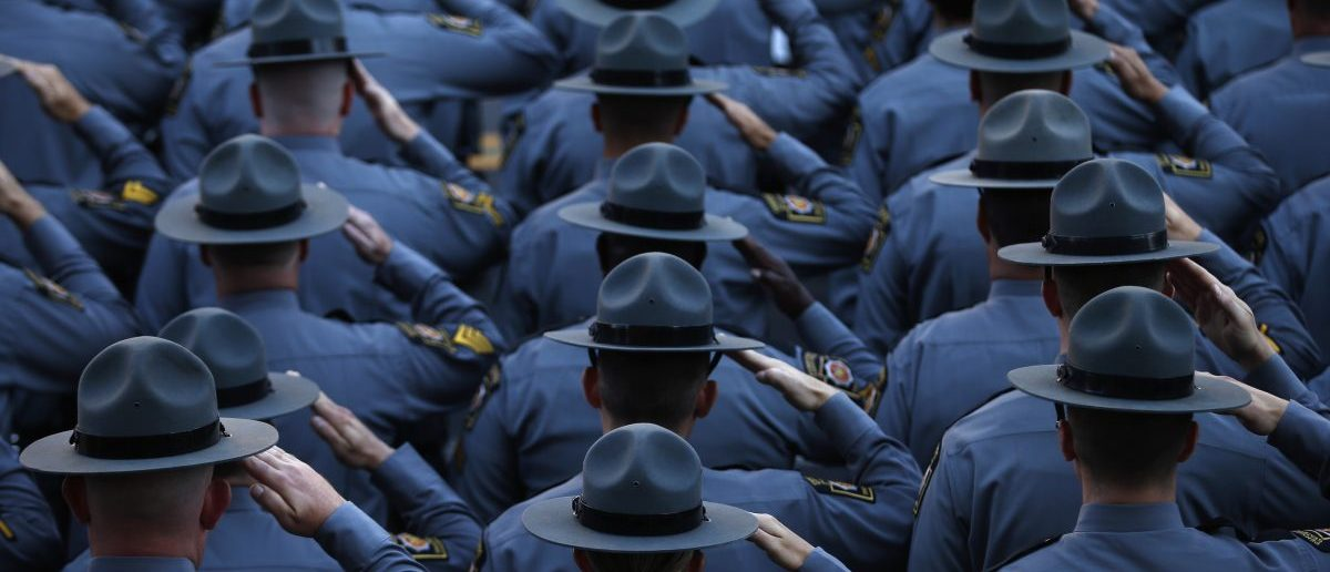 Pennsylvania State Police salute (REUTERS/Mike Segar)