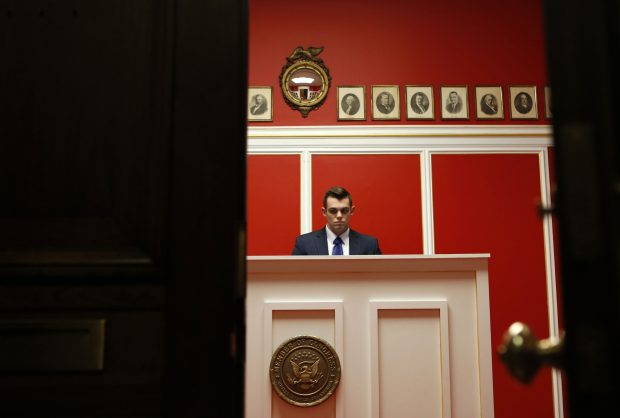 A staff member works at the office of Representative Aaron Schock (R-IL) on Capitol Hill in Washington March 17, 2015. Schock is resigning from Congress, U.S. House Speaker John Boehner said on Tuesday. Schock's resignation follows news reports that raised questions about his use of taxpayer dollars. He did not notify any House Republican leaders before making his decision, a House Republican aide said. REUTERS/Yuri Gripas (UNITED STATES - Tags: POLITICS) - RTR4TQUB