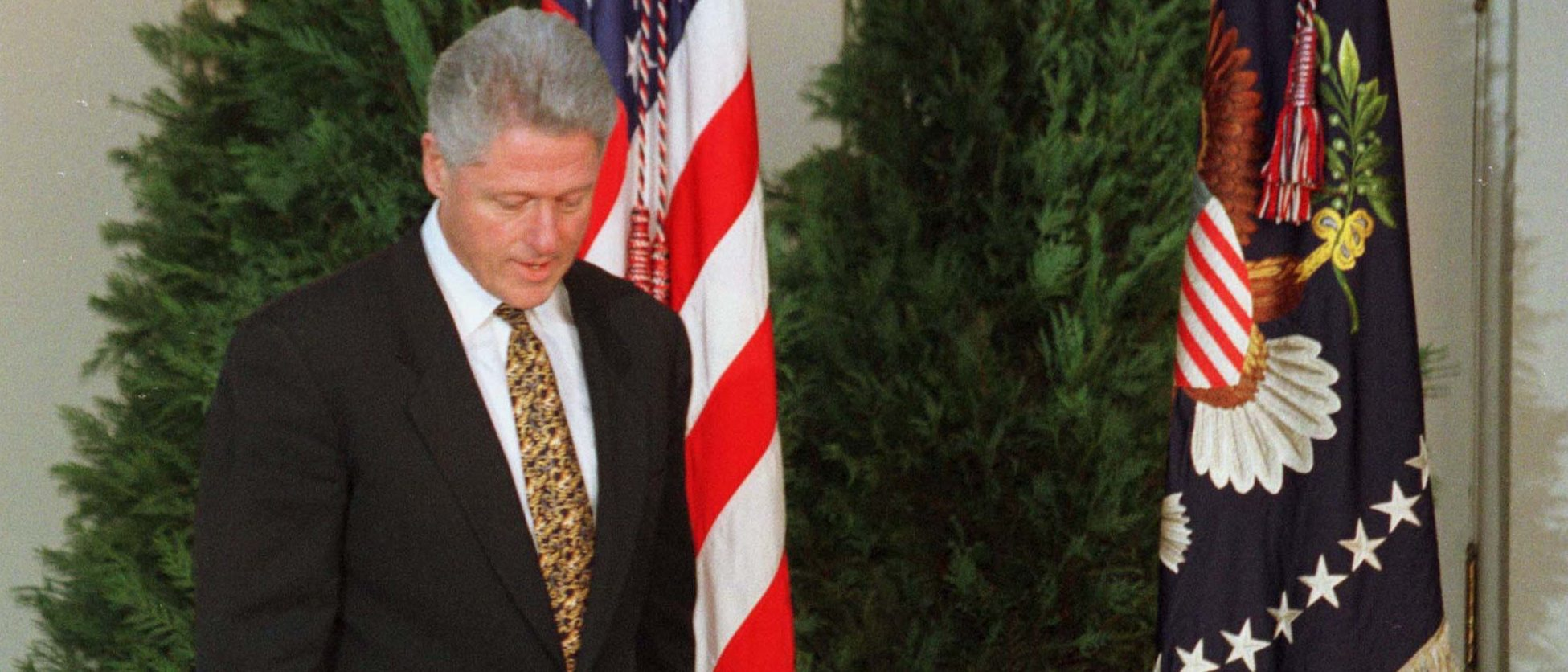 President Bill Clinton walks to the podium in the Rose Garden at the White House as he prepared to make a statement December 11, minutes before the House Judiciary Committee approved the first article of impeachment, 21-16. Clinton offered his profound appology for misleading the country about his affair with Monica Lewinsky.