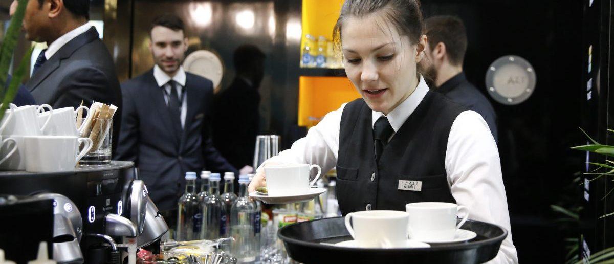 A waitress works at the bar (REUTERS/Fabrizio Bensch)