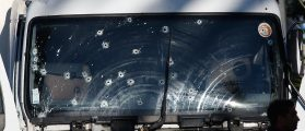 Bullet imacts are seen on the heavy truck the day after it ran into a crowd at high speed killing scores celebrating the Bastille Day July 14 national holiday on the Promenade des Anglais in Nice, France, July 15, 2016. (REUTERS/Eric Gaillard)