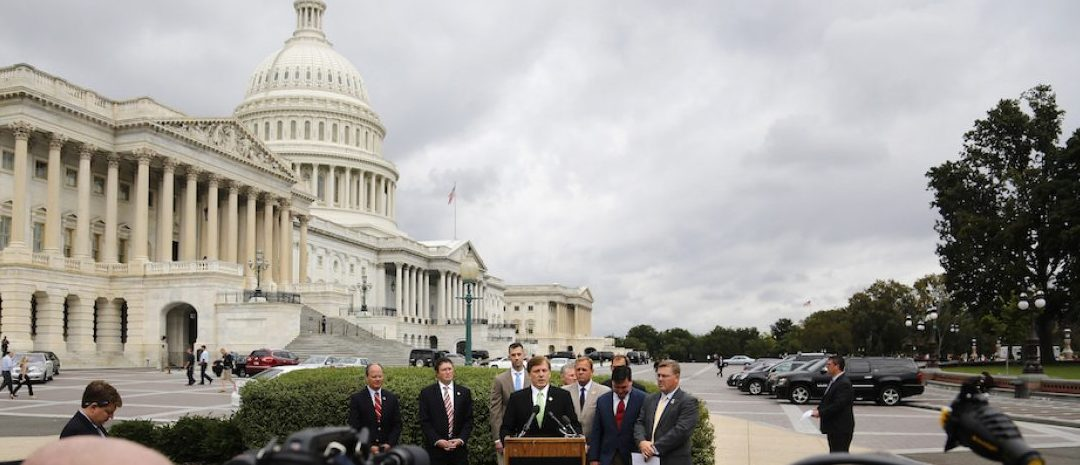 U.S. Representatives John Fleming (R-LA) (C, at lectern) and Eric Crawford (R-AR) (R, yellow tie) lead a news conference with fellow House Republicans to voice their opposition to funding the Affordable Care Act (commonly known as Obamacare) at the U.S. Capitol in Washington September 27, 2013. Republicans seek to delay the full implementation of Obamacare for one year, in return for raising U.S. borrowing authority to let Treasury borrow through the end of 2014. REUTERS/Jonathan Ernst