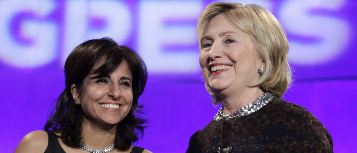 Former Secretary of State Hillary Clinton smiles next to President of the Center for American Progress Neera Tanden at the 10th Anniversary policy forum in Washington. REUTERS/Yuri Gripas