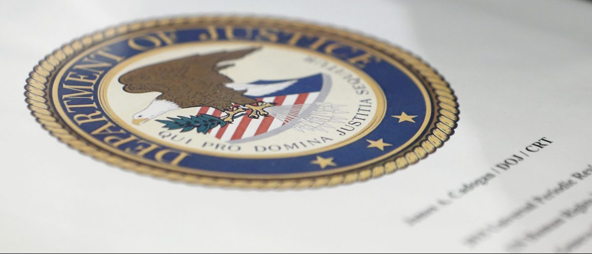 A folder with the seal of the Department of Justice, sits on a table prior to the start of the Universal Periodic Review of the U.S. at the United Nations European headquarters in Geneva, Switzerland, May 11, 2015