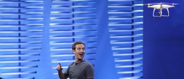 Facebook CEO Mark Zuckerberg looks at a flying drone on stage during the Facebook F8 conference in San Francisco, California April 12, 2016. REUTERS/Stephen Lam - RTX29NQ1