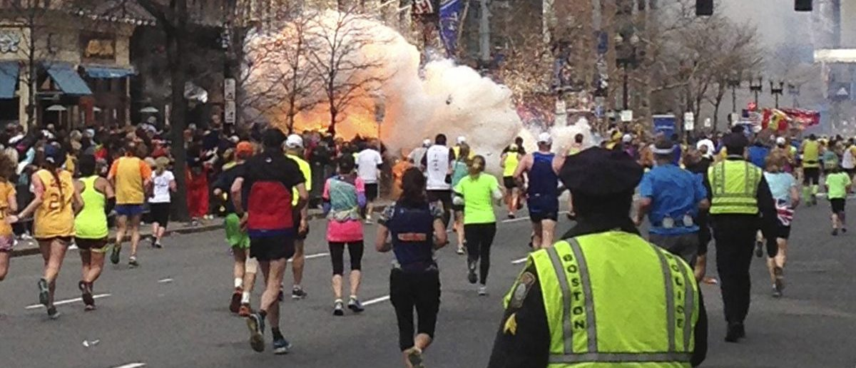 Runners continue to run towards the finish line of the Boston Marathon as an explosion erupts near the finish line of the race in this photo exclusively licensed to Reuters by photographer Dan Lampariello after he took the photo in Boston, Massachusetts, April 15, 2013. Two simultaneous explosions ripped through the crowd at the finish line of the Boston Marathon on Monday, killing at least two people and injuring dozens on a day when tens of thousands of people pack the streets to watch the world famous race. (REUTERS/Dan Lampariello)