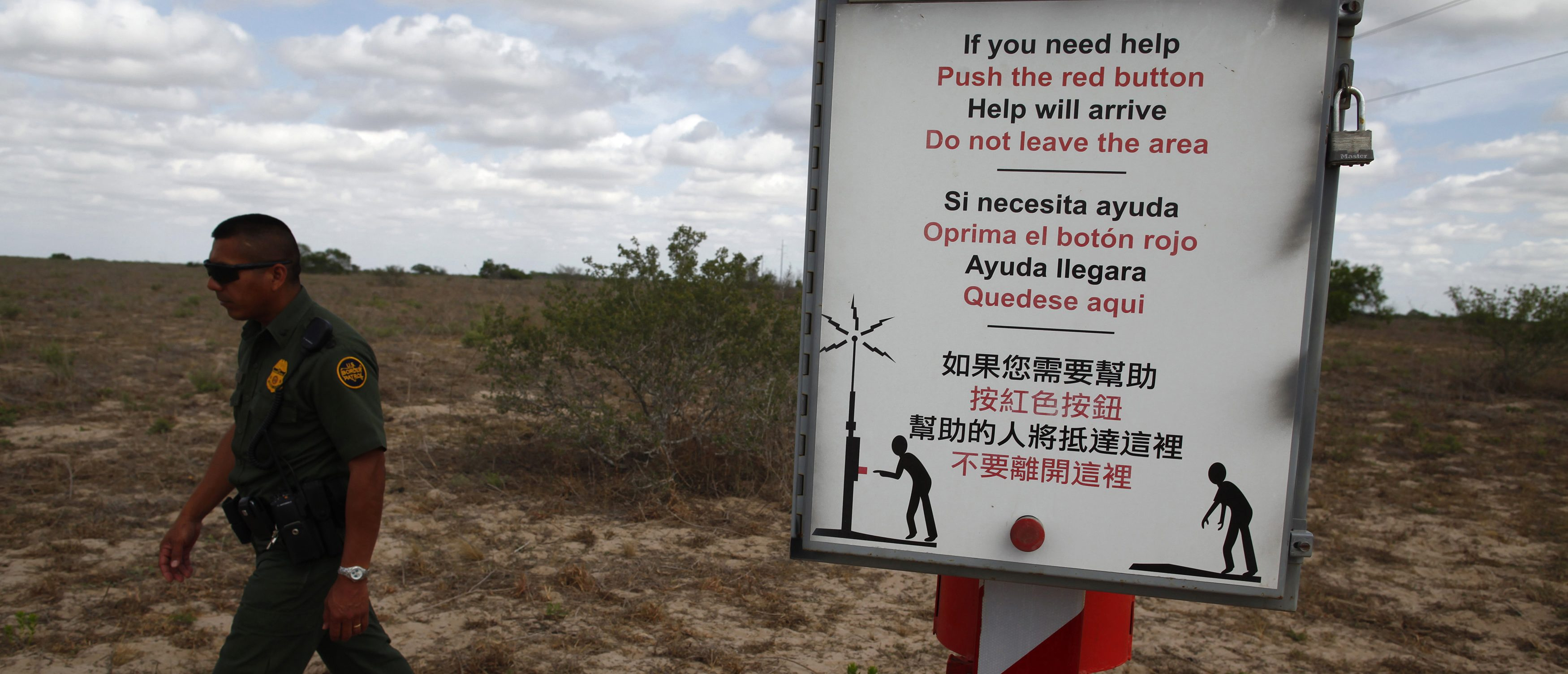 "A U.S. Border Patrol agent walks past a rescue beacon near Falfurrias, Texas March 29, 2013. Brooks County has become an epicentre for illegal immigrant deaths in Texas. In 2012, sheriff's deputies found 129 bodies there, six times the number recorded in 2010. Most of those who died succumbed to the punishing heat and rough terrain that comprise the ranch lands of south Texas. Many migrants spend a few days in a ""stash house"", such as the Casa del Migrante, in Reynosa, Mexico, and many are ignorant of the treacherous journey ahead. Picture taken March 29, 2013. REUTERS/Eric Thayer"