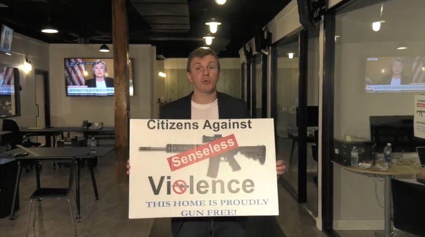 James O'Keefe holds a CASV sign (Project Veritas)