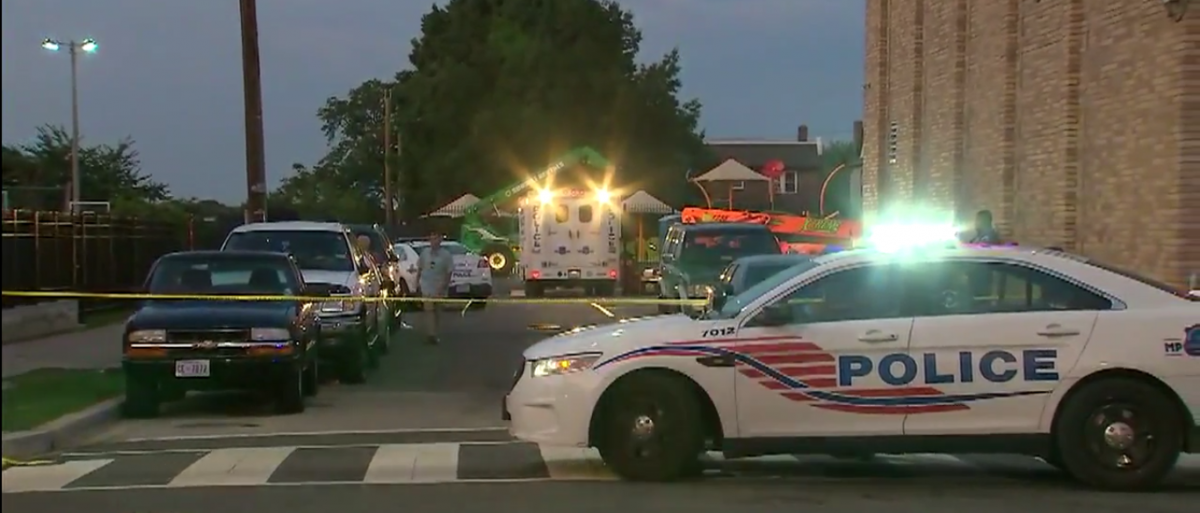 MPD officers at crime scene. (FOX5/Screenshot)