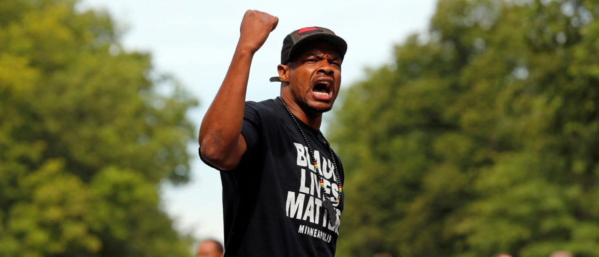 """Marques Armstrong chants in support of Philando Castile, who was fatally shot by Minneapolis area police during a traffic stop on Wednesday, at a """"Black Lives Matter"""" demonstration, in front of the Governor's Mansion in St. Paul, Minnesota, U.S., July 7, 2016. REUTERS/Eric Miller"""