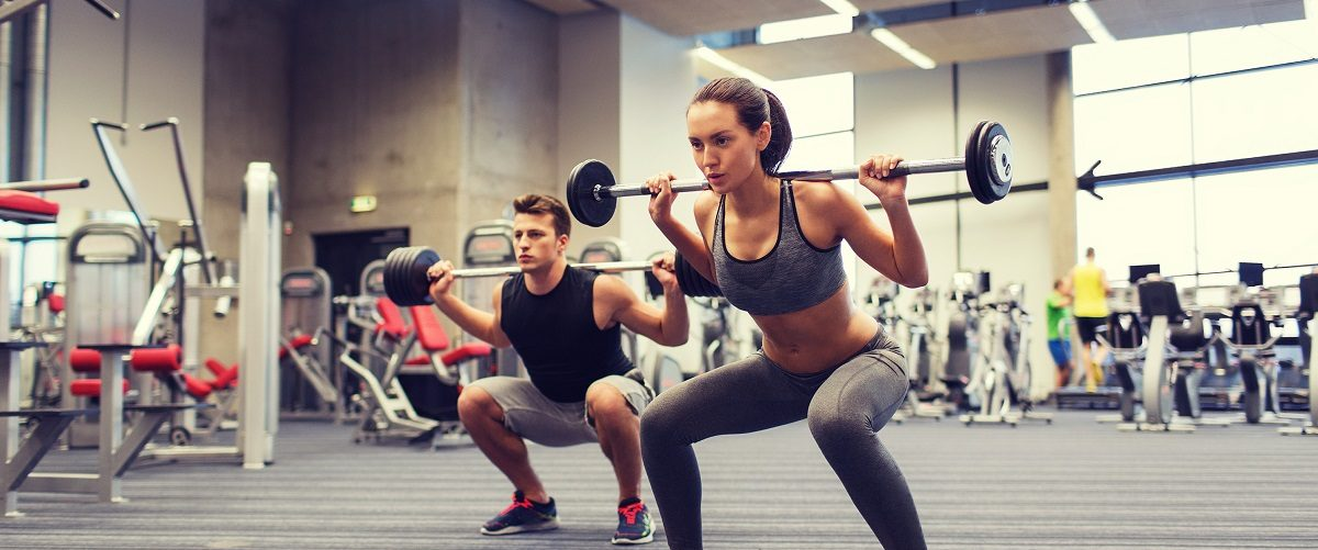 Squatting At The Gym (Syda Production/Shutterstock)