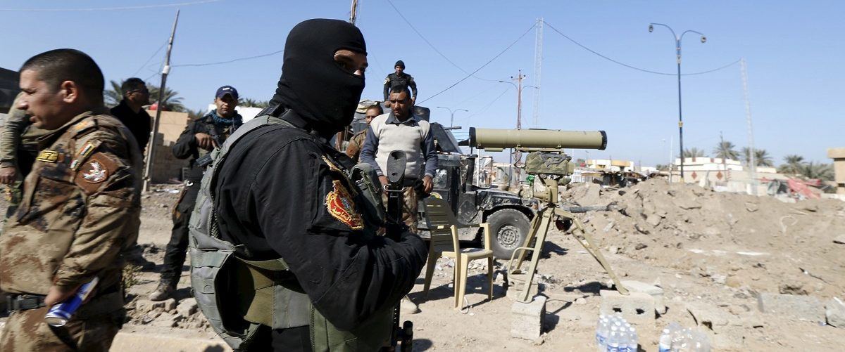 Iraqi security forces patrol in the city of Ramadi