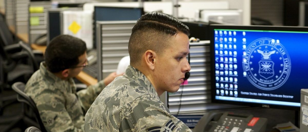 Sr Airman Jose Rivera, infrastructure technician U.S. Air Force, works at the 561st Network Operations Squadron (NOS) at Petersen Air Force Base in Colorado Springs, Colorado July 20, 2015.  The 561st NOS executes defensive cyber operations in response to U.S. Cyber Command orders and intelligence based threats.    REUTERS/Rick Wilking